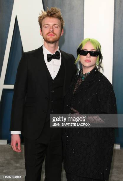 US singersongwriter Billie Eilish and her brother Finneas O'Connell attend the 2020 Vanity Fair Oscar Party following the 92nd Oscars at The Wallis...