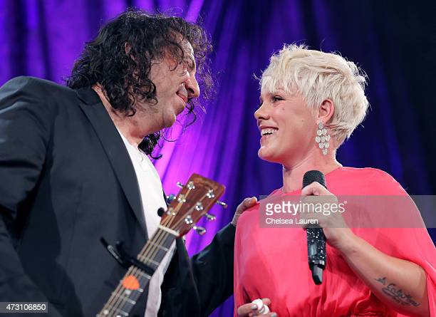 Singersongwriter Billy Mann and honoree Pnk perform onstage during the 63rd Annual BMI Pop Awards held at the Beverly Wilshire Hotel on May 12 2015...