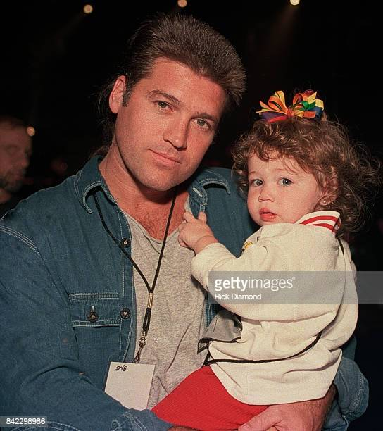 Singer/Songwriter Billy Ray Cyrus and daughter Miley Cyrus attends Elvis The Tribute at The Pyramid Arena in Memphis Tennessee October 08 1994