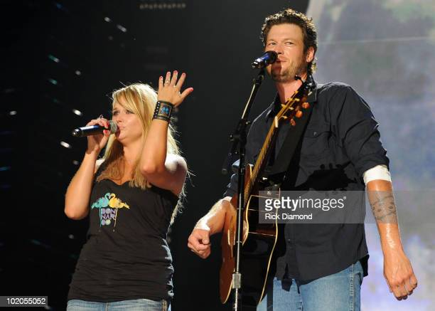 Singer/Songwriter Blake Shelton is joined by Singer/Sonwriter and Fiancee Miranda Lambert who shows her ring after performing during the 2010 CMA...
