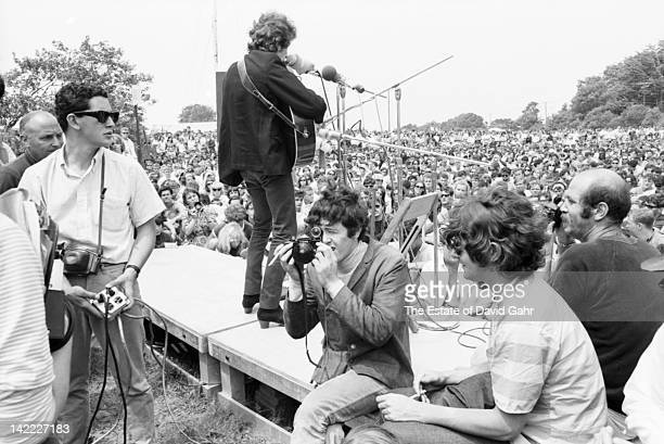Singer/songwriter Bob Dylan performs at the Newport Folk Festival in July 1965 in Newport Rhode Island Singer/songwriter Donovan making his US debut...