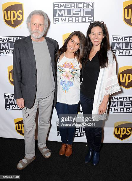 Singer/songwriter Bob Weir Chloe Kaelia Weir and Natascha Munter attends the 2014 American Music Awards UPS Gifting Suite at Nokia Theatre LA Live on...