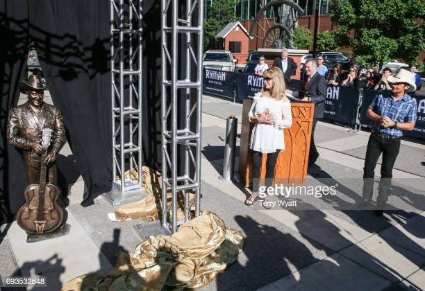 Singersongwriter Brad Paisley and Mona Dickens attend the unveiling of statues of Little Jimmy Dickens and Bill Monroe at Ryman Auditorium on June 7...