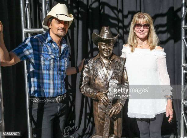 Singer-songwriter Brad Paisley and Mona Dickens attend the unveiling of statues of Little Jimmy Dickens and Bill Monroe at Ryman Auditorium on June...