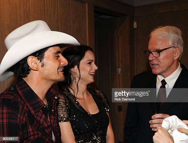 Singer/Songwriter Brad Paisley his wife Actress Kimberlly Williams chat backstage with Comedian/Musician Steve Martin backstage at the GRAMMY salute...