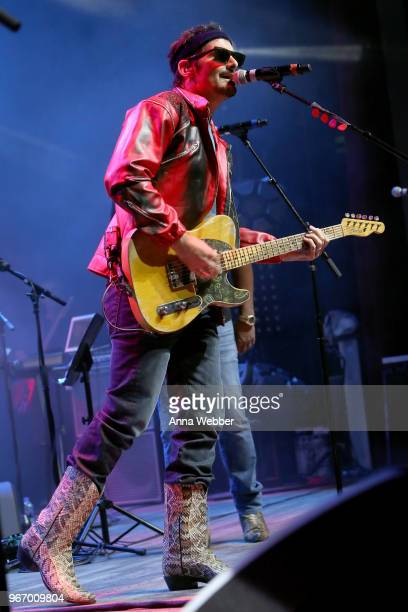 Singersongwriter Brad Paisley performs onstage during Nashville '80s Dance Party benefiting The Alzheimer's Association at Wild Horse Saloon on June...
