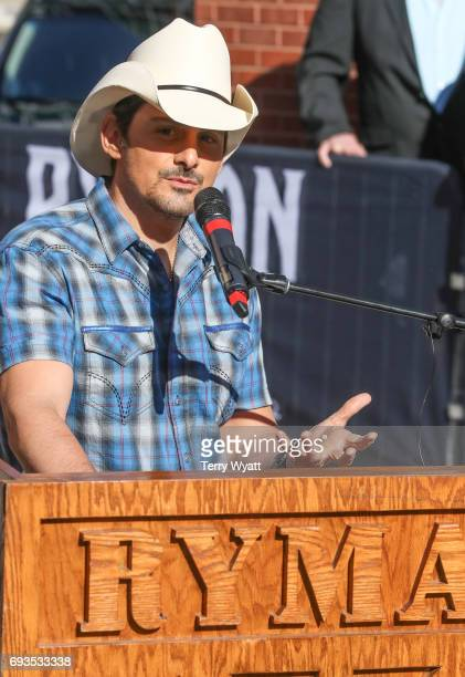 Singer-songwriter Brad Paisley speaks during the unveiling of statues of Little Jimmy Dickens and Bill Monroe at Ryman Auditorium on June 7, 2017 in...