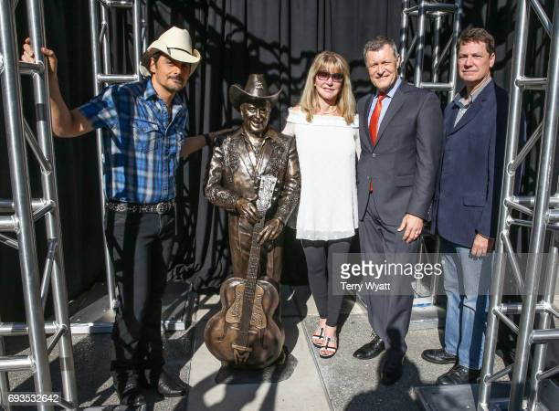 Singersongwriter Brad PaisleyMona DickensBill Cody and sculptor Ben Watts attend the unveiling of statues of Little Jimmy Dickens and Bill Monroe at...