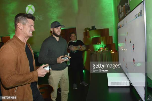 Singersongwriter Brad Rempel of High Valley and NHL player Nick Bonino test out the new games at the Xbox Halloween Gaming Event hosted by Brad...