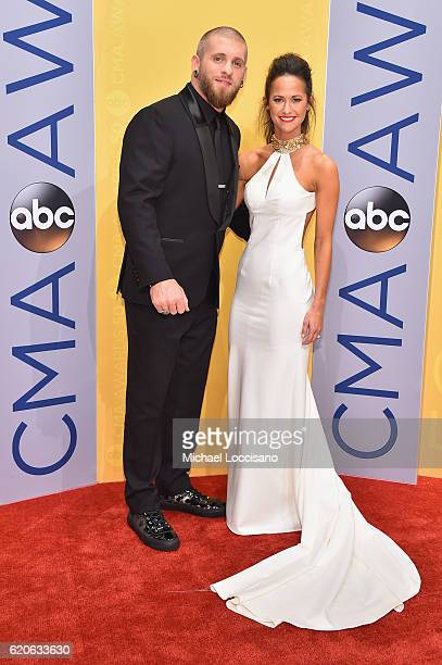 Singersongwriter Brantley Gilbert and Amber Cochran attend the 50th annual CMA Awards at the Bridgestone Arena on November 2 2016 in Nashville...