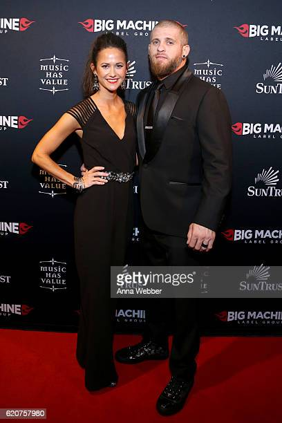 Singersongwriter Brantley Gilbert and Amber Cochran attend the Big Machine Label Group's celebration of the 50th Annual CMA Awards at Marathon Music...