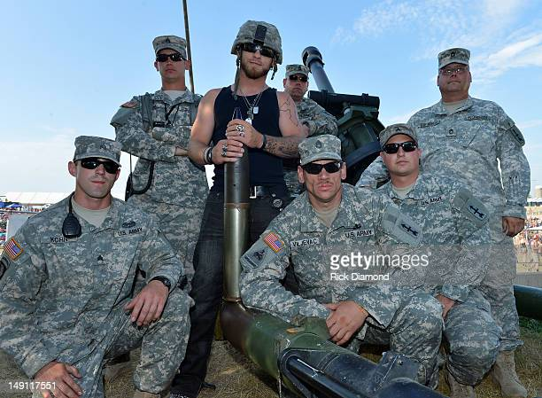 Singer/Songwriter Brantley Gilbert fires a Howitzer 105mm cannon with the help of members of the Wisconsin National Guard during Country Thunder Day...
