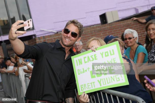 Singersongwriter Brett Young takes a selfie with fans during the 11th Annual ACM Honors at the Ryman Auditorium on August 23 2017 in Nashville...