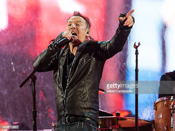 Singersongwriter Bruce Springsteen is seen performing with U2 during a Surprise World AIDS Day concert at Times Square on December 1 2014 in New York...