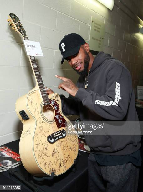Singersongwriter Bryson Tiller poses with the GRAMMY Charities Signings during the 60th Annual GRAMMY Awards at Madison Square Garden on January 27...