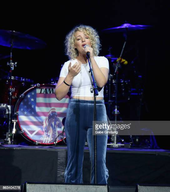 Singer/songwriter Cam performs during Vegas Strong A Night of Healing at the Orleans Arena on October 19 2017 in Las Vegas Nevada The concert...