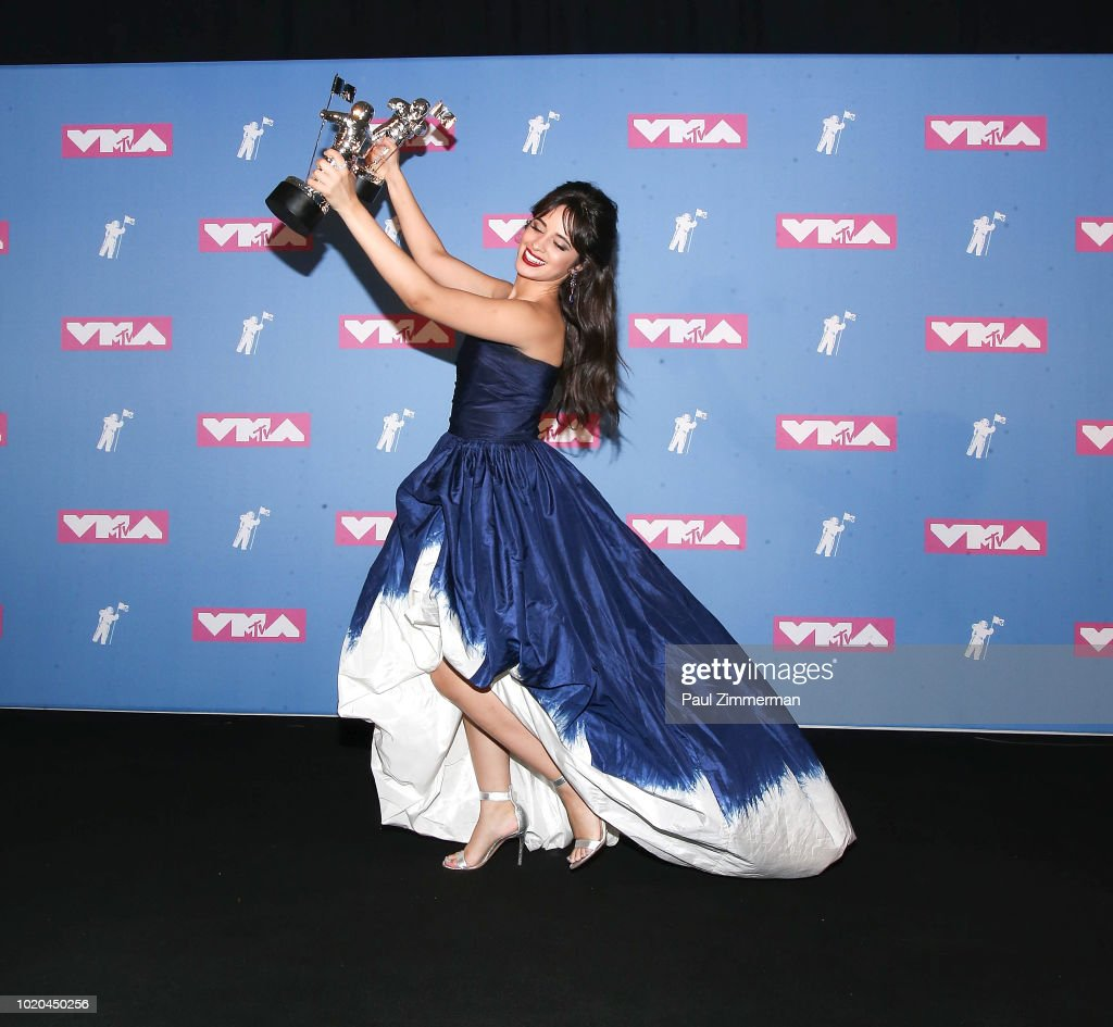 singer/songwriter Camila Cabello holds her 2 awards for Video of the Year and Artist of the Year in the press room at the 2018 MTV Video Music Awards at Radio City Music Hall on August 20, 2018 in New York City.