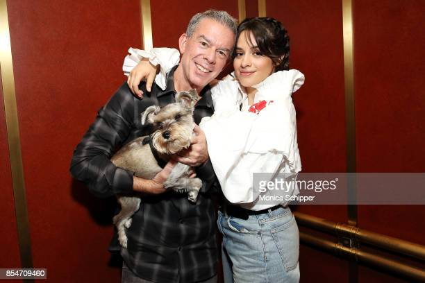Singersongwriter Camila Cabello poses for a photo with host Elvis Duran and his dog Max when she visits 'The Elvis Duran Z100 Morning Show' at Z100...