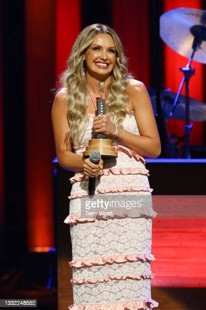 Singer-songwriter Carly Pearce speaks during her Induction to the Grand Ole Opry at Grand Ole Opry House on August 03, 2021 in Nashville, Tennessee.