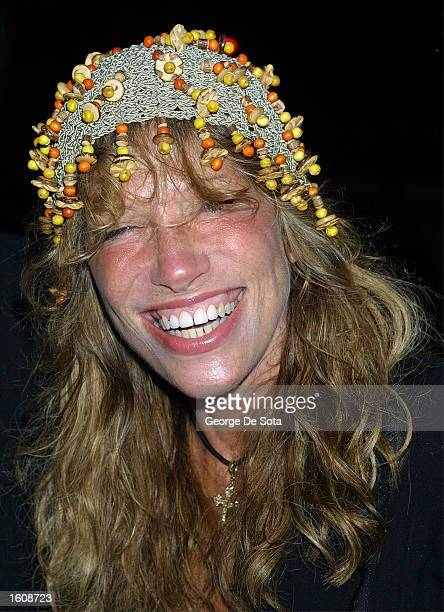 """Singer/songwriter Carly Simon attends a rainy openning night of """"The Seagull"""" August 12, 2001 at the Delacorte Theatre in New York City''s Central..."""
