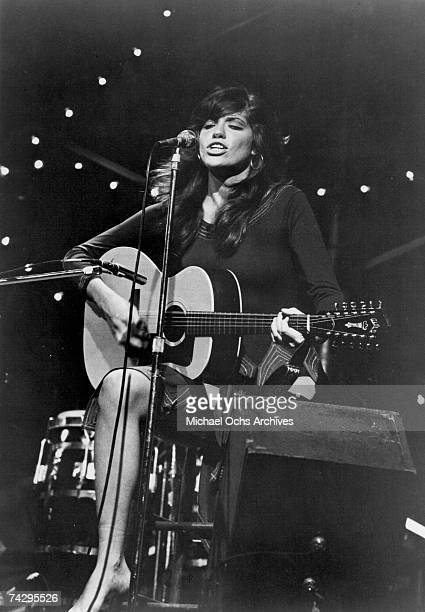 Singer/songwriter Carly Simon performs onstage with a Guild 12string acoustic guitar in circa 1972