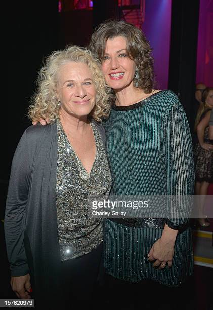 Singer/songwriter Carole King and singer Amy Grant attend a celebration of Carole King and her music to benefit Paul Newman's The Painted Turtle Camp...