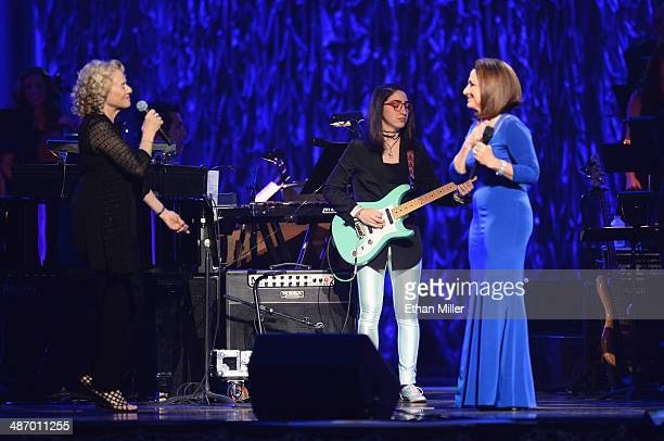 Singer/songwriter Carole King musician Emily Estefan and honoree Gloria Estefan perform onstage during the 18th annual Keep Memory Alive 'Power of...