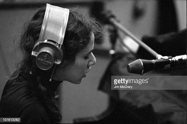 Singersongwriter Carole King sings into a microphone wearing headphones during the recording of her album 'Tapestry' at AM Records Recording Studio...