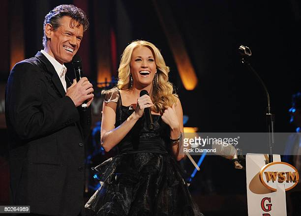 Singer/Songwriter Carrie Underwood is suprised by Opry Member and Singer/Songwriter Randy Travis when Randy invites Carrie to become a member of The...