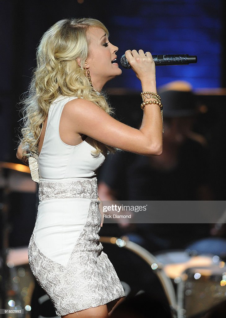 Taping of cmt invitation only featuring carrie underwood photos singersongwriter carrie underwood performs during the taping of cmt invitation only featuring carrie underwood stopboris Images