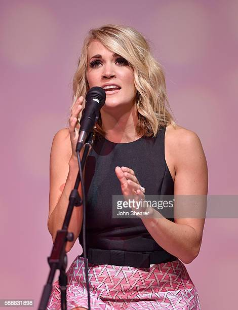 Singersongwriter Carrie Underwood performs number one songs 'Heartbeat' and 'Church Bells' on August 11 2016 in Nashville Tennessee