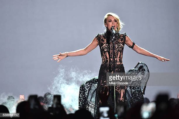 Singersongwriter Carrie Underwood performs onstage during the 2016 CMT Music awards at the Bridgestone Arena on June 8 2016 in Nashville Tennessee