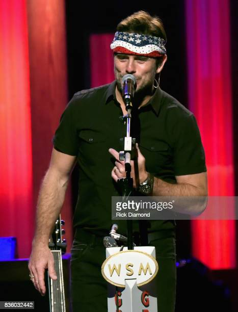 Singer/Songwriter Charles Esten wears Wynonna Judd head band on stage during Grand Ole Opry Total Eclipse 2017 Special Sunday Night Show at Grand Ole...