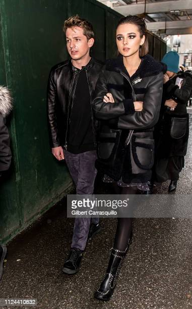 Singersongwriter Charlie Puth and singer Charlotte Lawrence are seen leaving the Coach 1941 fashion show at the NYSE during New York Fashion Week on...