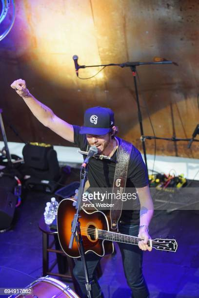 Singersongwriter Chris Janson performs onstage at the HGTV Lodge during CMA Music Fest on June 11 2017 in Nashville Tennessee
