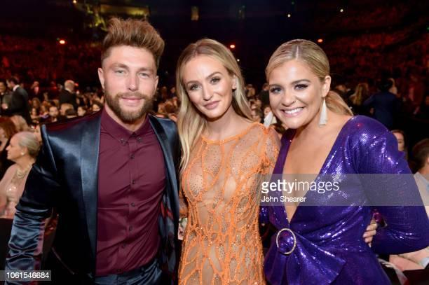 Singersongwriter Chris Lane TV personality Lauren Bushnell and singersongwriter Lauren Alaina attends the 52nd annual CMA Awards at the Bridgestone...