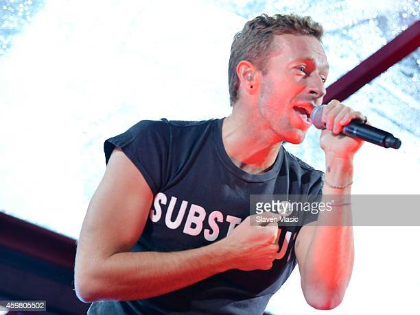 Singersongwriter Chris Martin of Coldplay performs on World AIDS Day at 'A Thank You' presented by RED on December 1 2014 in New York City Photo by...