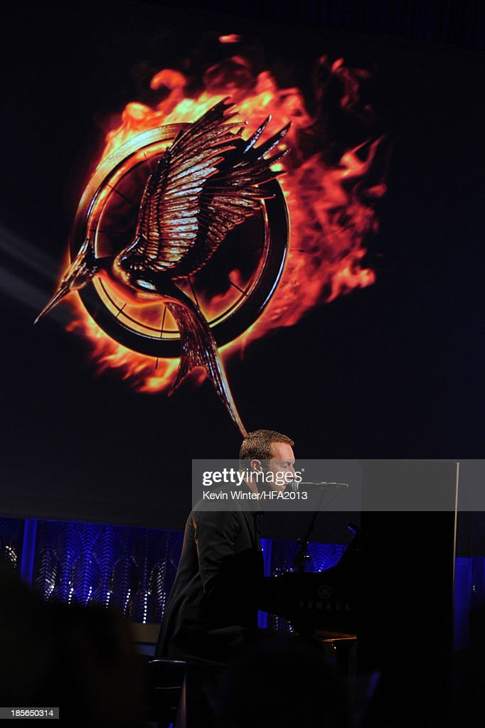 Singer-songwriter Chris Martin performs onstage during the 17th annual Hollywood Film Awards at The Beverly Hilton Hotel on October 21, 2013 in Beverly Hills, California.