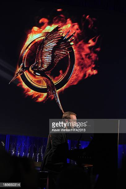 Singersongwriter Chris Martin performs onstage during the 17th annual Hollywood Film Awards at The Beverly Hilton Hotel on October 21 2013 in Beverly...