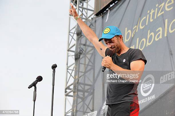 Singersongwriter Chris Martin speaks onstage during Global Citizen 2015 Earth Day on National Mall to end extreme poverty and solve climate change on...