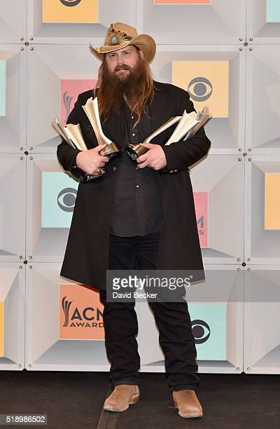 Singersongwriter Chris Stapleton winner of the Male Vocalist of the Year New Male Vocalist of the Year and Album of the Year awards poses in the...