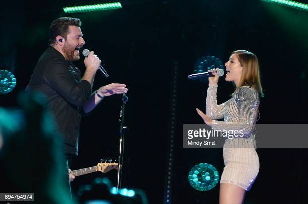 Singer/songwriter Chris Young and singer Cassadee Pope perform at Nissan Stadium during day 3 of the 2017 CMA Music Festival on June 10 2017 in...