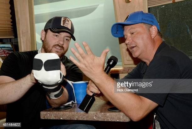 Singer/Songwriter Chris Young and SiriusXM's Buzz Brainard compare scars on Chris Young's tour bus backstage during 'Kicker Country Stampede' at...
