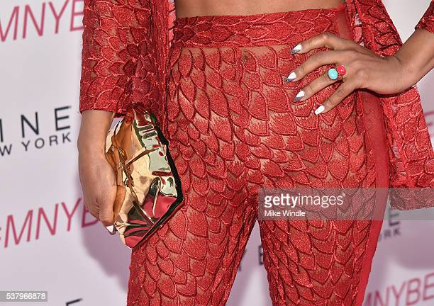 Singersongwriter Christina Milian accessory details attends the Maybelline New York celebration of their latest collection with an LA beauty bash...