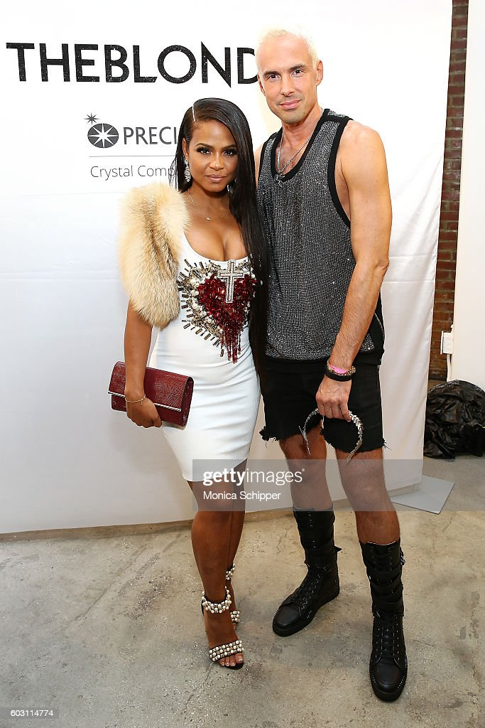Singer-songwriter Christina Milian (L) poses for a photo with designer David Blond, backstage at The Blonds fashion show during MADE Fashion Week September 2016 at Milk Studios on September 11, 2016 in New York City.