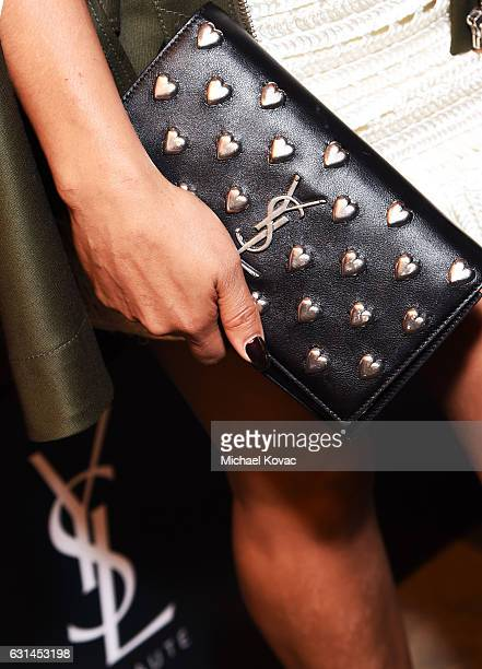 Singer/songwriter Christina Milian purse detail attends the YSL Beauty Club Party at the Ace Hotel on January 10 2017 in Downtown Los Angeles...