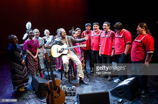 Singersongwriter Citizen Cope plays music with Turnaround Arts Red Lake Middle School students that he mentors on April 1 2016 at the Lincoln Theatre...