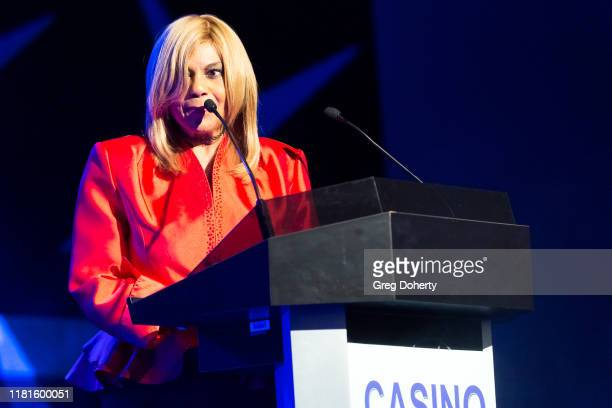 Singer/songwriter Claudette Rogers Robinson introduces singer Martha Reeves recipient of the Casino Entertainment Legend Award at the Global Gaming...