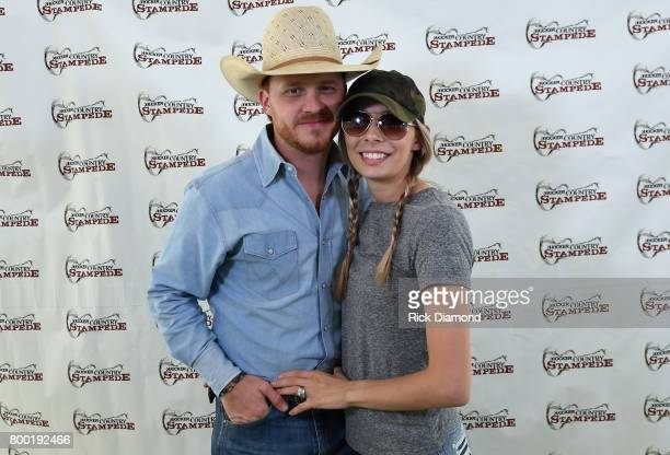Singer/Songwriter Cody Johnson and his wife Brandi Johnson backstage during Kicker Country Stampede Day 2 at Tuttle Creek State Park on June 23 2017...