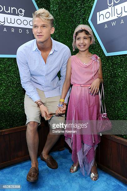 Singer/songwriter Cody Simpson and Make a Wish recipient Wish Child Grace attend the 2014 Young Hollywood Awards brought to you by Samsung Galaxy at...